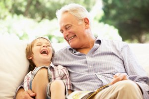 Boy laughing with grandfather